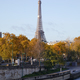 Eiffel tower and Seine river docks with autumn trees in a sunny day in Paris, France - PhotoDune Item for Sale