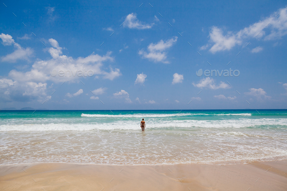 girl on beach back view - Stock Photo - Images