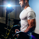 bodybuilder pumping up hands in gym - PhotoDune Item for Sale