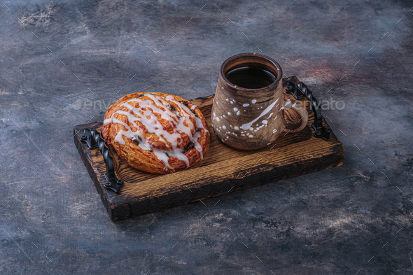 Sweet pastry with cup of coffee on wooden board - Stock Photo - Images
