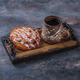 Sweet pastry with cup of coffee on wooden board - PhotoDune Item for Sale