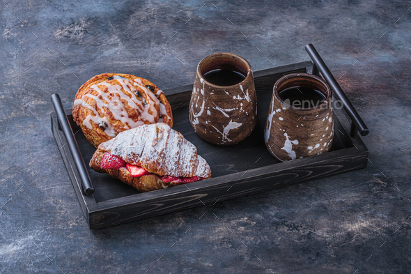 Delicious croissant and two cups of coffee for breakfast, copy space - Stock Photo - Images