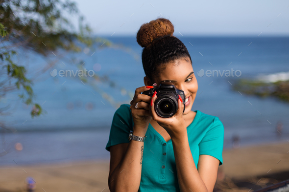 African American woman  photographer taking outdoor photos -  Black people - Stock Photo - Images