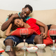 Black African American couple watching tv in the living room - PhotoDune Item for Sale