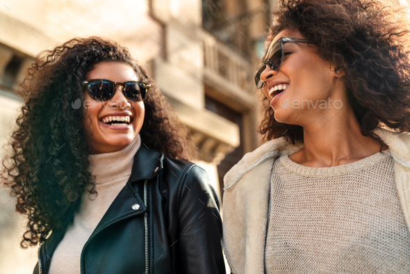 Two beautiful young stylish african women - Stock Photo - Images
