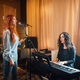 student girl sings in a vocal lesson to accompaniment of a teacher on an electronic keyboard - PhotoDune Item for Sale