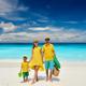 Family with three year old boy on beach. Seychelles, Mahe. - PhotoDune Item for Sale