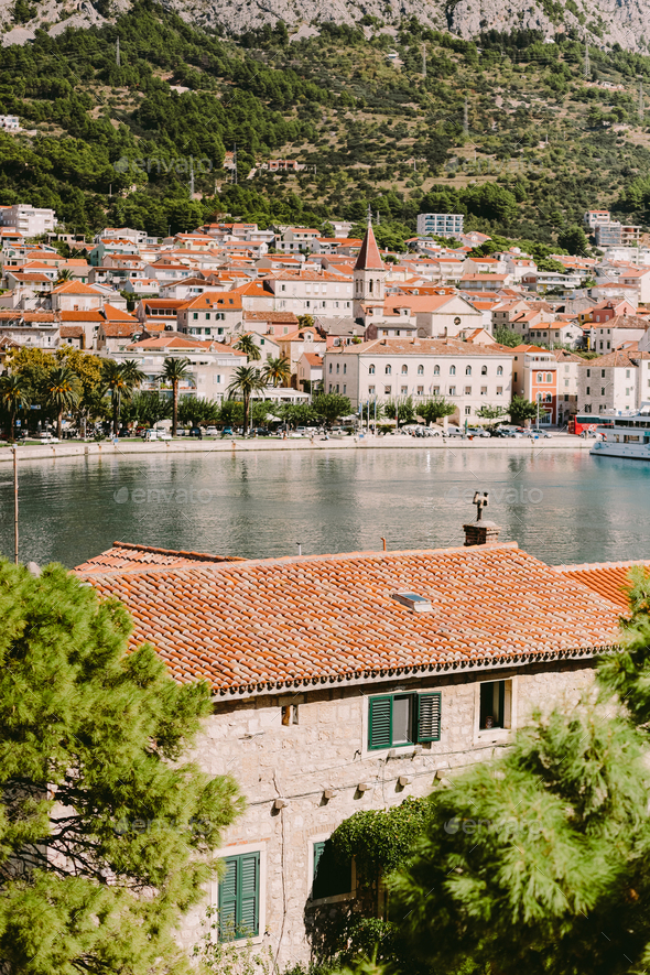 Old town view with mountains and red roofs in Croatia - Stock Photo - Images