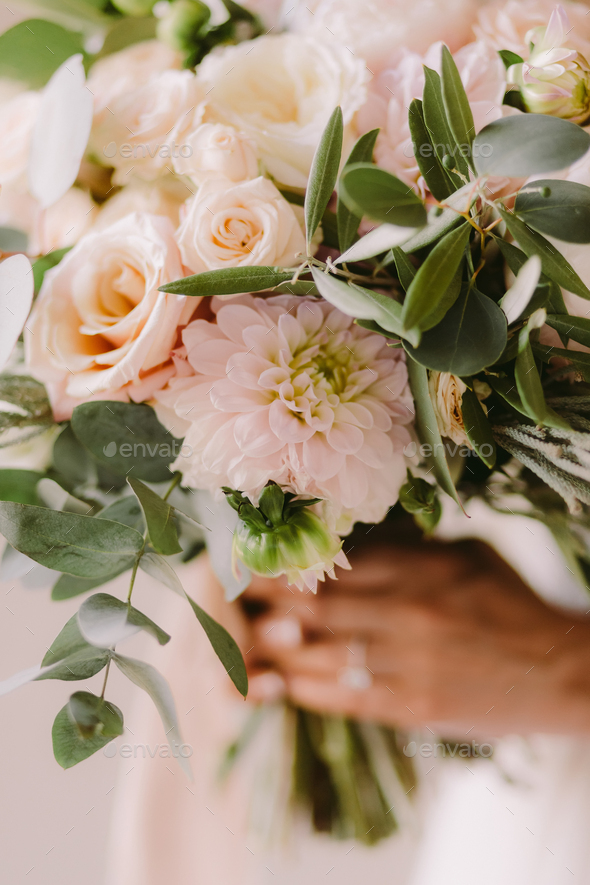 bride holding wedding bouquet in fine art style - Stock Photo - Images