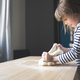 little Caucasian girl working the dough on a wood cutting board - PhotoDune Item for Sale