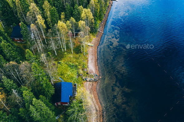 Aerial top view of log cabin or cottage with sauna in spring forest by the lake in Finland - Stock Photo - Images