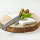 Two sharp kitchen knives on round wood slab - PhotoDune Item for Sale