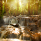 Pa Wai Waterfall with sun rays shining through the trees, Tak Thailand - PhotoDune Item for Sale