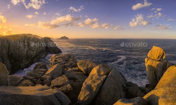 Sea Cliffs Gilted by the Light of the Setting Sun - Stock Photo - Images
