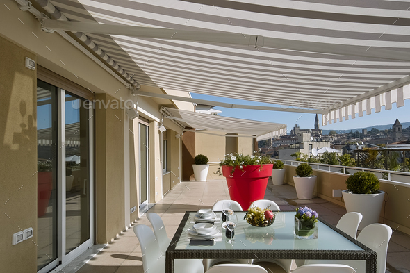 Exterior Shots of a Modern Terrace with Dining Table - Stock Photo - Images