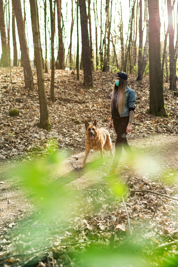 Casual Woman Walking Dog in Forest while Wearing Protective Face Mask. - Stock Photo - Images