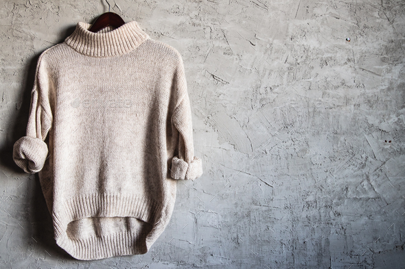 Beige Warm Long Sleeve Shirt on Black Hanger Hang on gray background - Stock Photo - Images