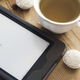 E-book reader and tea cup - PhotoDune Item for Sale