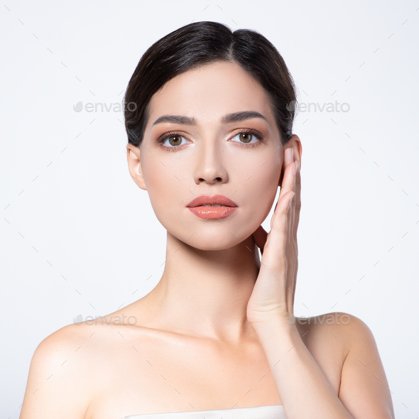 Beautiful face of young woman with health fresh skin. - Stock Photo - Images