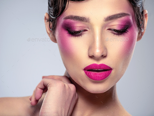 Beautiful fashion woman with  a purple lipstick on her lips. - Stock Photo - Images