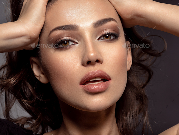 Beautiful woman with brown hair. Attractive model with brown eyes. - Stock Photo - Images
