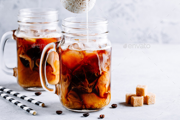Coconut Milk Thai Iced Coffee with Coffee Ice Cubes - Stock Photo - Images