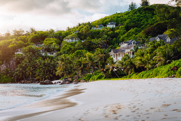 Mahe, Seychelles. Exotic tropical beach Anse Intendance in evening sunset light. Scenic view of - Stock Photo - Images