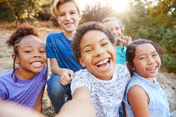 POV Shot Of Multi-Cultural Children Posing For Selfie With Friends In Countryside Together - Stock Photo - Images