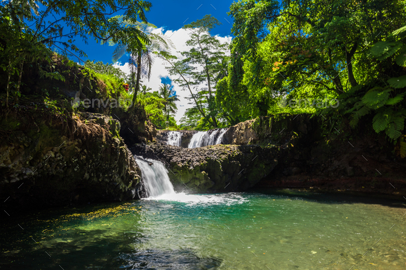 Vibrant Togitogiga falls with swimming hole on Upolu, Samoa Islands - Stock Photo - Images
