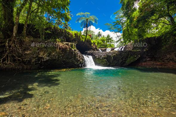 Vibrant Togitogiga falls with swimming hole on Upolu, Samoa Islands - Stock Photo - Images