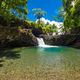 Vibrant Togitogiga falls with swimming hole on Upolu, Samoa Islands - PhotoDune Item for Sale