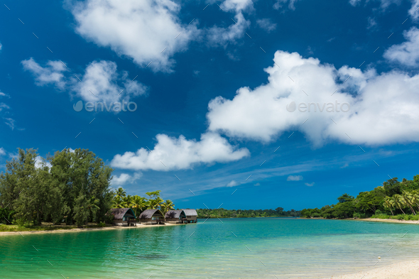 Tropical resort destination in Port Vila, Efate Island, Vanuatu, beach and palm trees - Stock Photo - Images