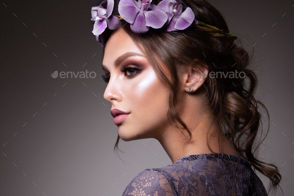 Beautiful Girl with Flowers. Pastel Colors. Perfect Face Skin - Stock Photo - Images