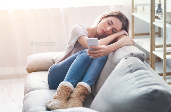 Woman lonely at home during coronavirus epidemic - Stock Photo - Images