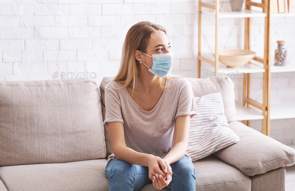 Girl in mask stayed at home during coronavirus quarantine - Stock Photo - Images