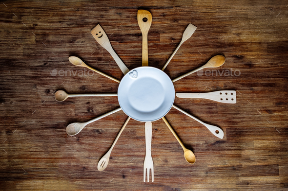 Wooden cooking spoons in shape of a clock on textured table, vintage style - Stock Photo - Images