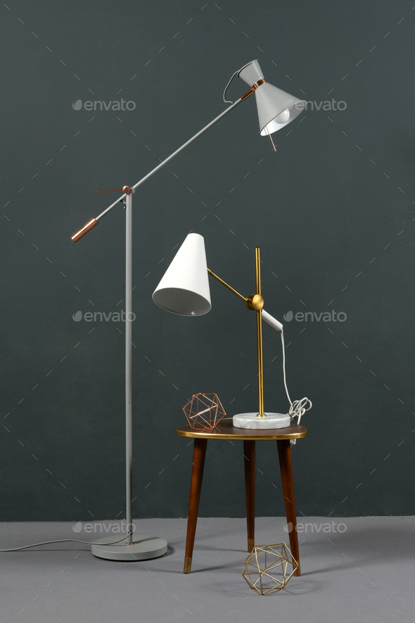 Two vintage anglepoise lamps in a grey interior - Stock Photo - Images