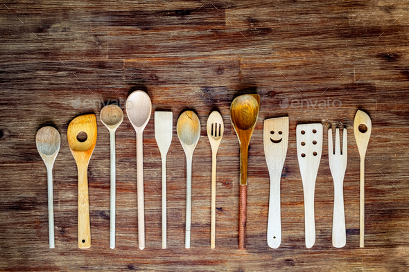 Detail of wooden cooking spoons on textured wooden table, vintage style - Stock Photo - Images