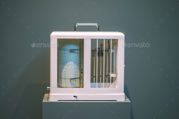 Seismological device for measuring earthquakes. Seismograph records an earthquake on the sheet of - Stock Photo - Images