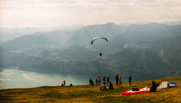 Paraglider on Mote Baldo andl ake Garda in Italy - Stock Photo - Images