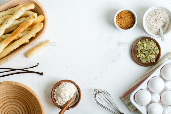 Natural organic ingredients for baking homemade traditional bread or cakes on a light grey marble - Stock Photo - Images