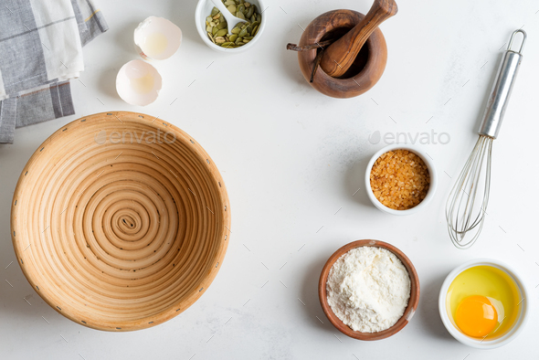 Homemade production of fresh healthy bread of other pastry from natural ingredients on a light grey - Stock Photo - Images