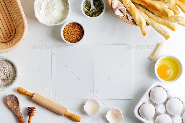 Baking ingredients for cooking homemade traditional bread with paper for recipe on a light grey - Stock Photo - Images