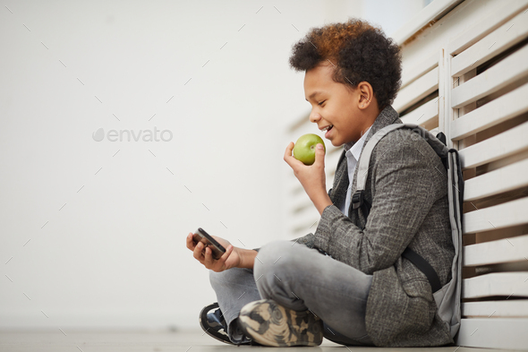 Schoolboy resting after lessons - Stock Photo - Images