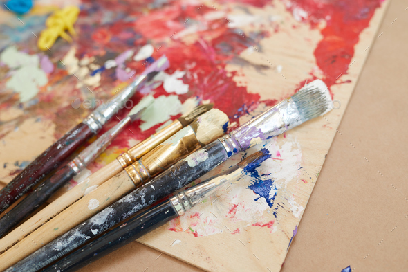 Paintbrushes with paintings - Stock Photo - Images