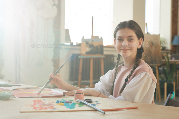 Little girl painting at art studio - Stock Photo - Images