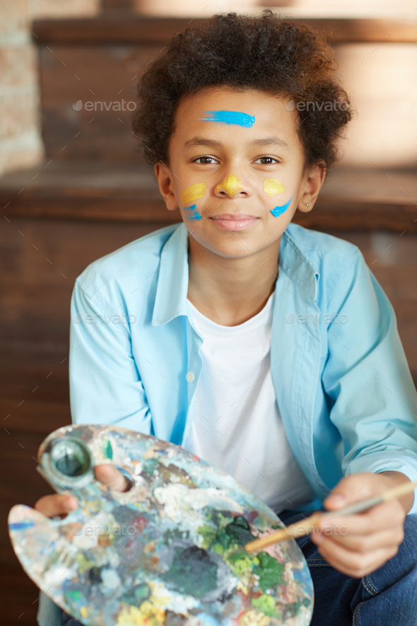 Young artist with paints - Stock Photo - Images