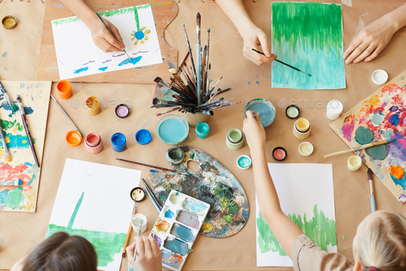 Children painting at the table - Stock Photo - Images