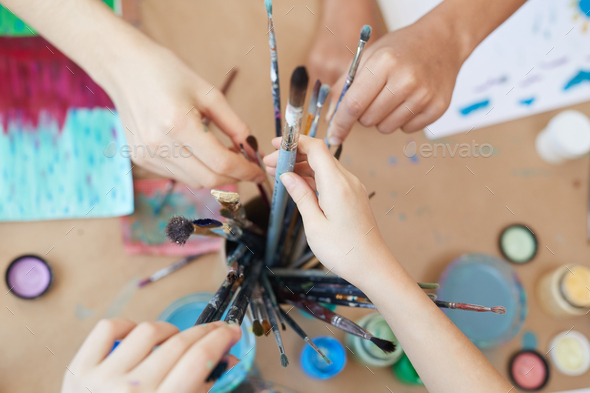 People taking paintbrush for painting - Stock Photo - Images