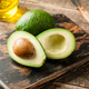 Fresh green avocado and oil on wooden table - PhotoDune Item for Sale
